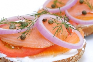 Bagel and Lox. Smoked salmon, cream cheese, tomato, red onion, capers and dill.