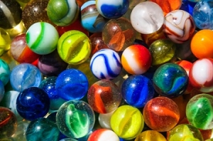 A collection of old worn and chipped glass marbles found at a Connecticut flea market.